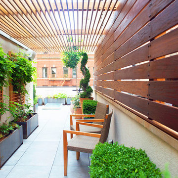 Rooftop Garden with Pergola and Fencing for Outdoor Seating Area