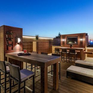 Inspiration för stora moderna takterrasser, med utekrukor