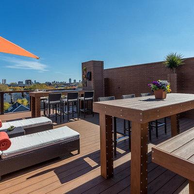 Deck container garden - large contemporary rooftop deck container garden idea in Chicago with no cover