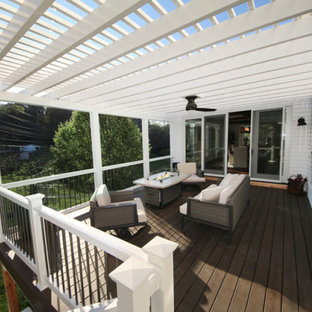 Large arts and crafts backyard deck photo in St Louis with a fireplace and an awning