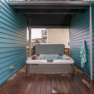 Ejemplo de terraza costera, de tamaño medio, en anexo de casas, con ducha exterior