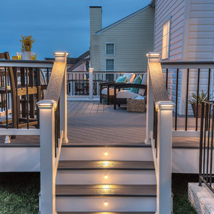 Deck - mid-sized traditional backyard deck idea in Other with no cover