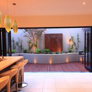 Foto di una terrazza design con fontane