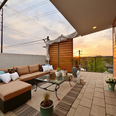 Inspiration for a contemporary deck container garden remodel in Austin with a roof extension