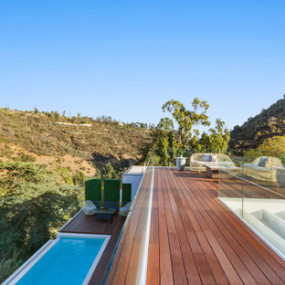 Large trendy rooftop privacy deck photo in Los Angeles with no cover