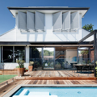 Inspiration for a mid-sized contemporary backyard deck in Melbourne with an outdoor kitchen and a pergola.