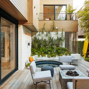 Deck - coastal backyard deck idea in Los Angeles with a fire pit and no cover