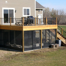 Traditional Deck by West Construction, Inc