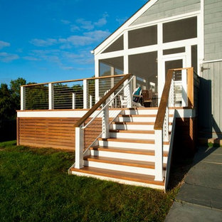 Deck skirting - large transitional backyard deck skirting idea in DC Metro with no cover