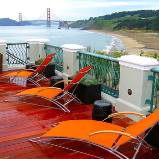 This is an example of a mid-sized beach style backyard deck in San Francisco with no cover.