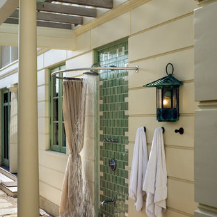 Design ideas for a beach style deck in New York with an outdoor shower and a pergola.