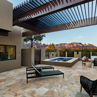 Inspiration for a southwestern deck remodel in Phoenix with a pergola