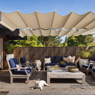Deck - mid-sized mid-century modern backyard deck idea in San Francisco with an awning