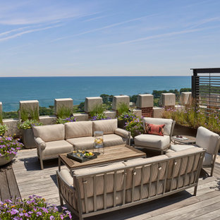 Huge transitional rooftop privacy deck photo in Chicago with no cover