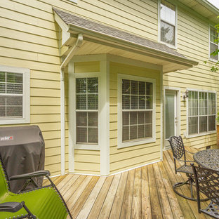 Photo of a mid-sized traditional side yard deck in Other with no cover.
