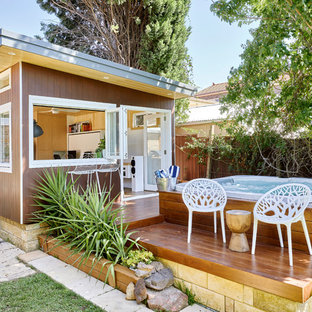 This is an example of a small contemporary side yard deck in Sydney with a container garden and no cover.