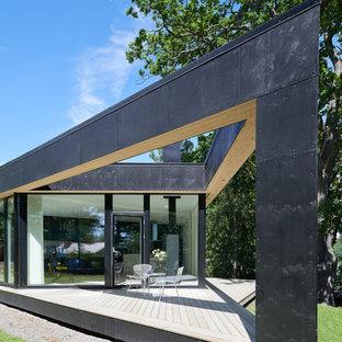 Inspiration for a large scandinavian backyard deck remodel in Stockholm
