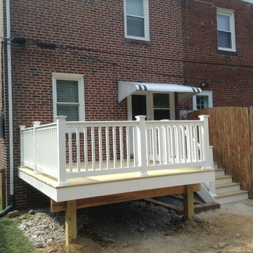 Small 12x12 Deck with walkway above basement stairs.