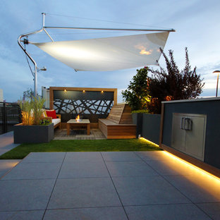 Inspiration for a small modern roof terrace and balcony in Chicago with an outdoor kitchen and an awning.