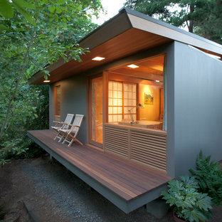 Inspiration for a small contemporary deck remodel in Portland with a roof extension