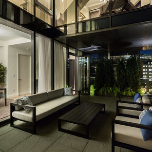 Example of a mid-sized trendy rooftop deck design in New York with no cover