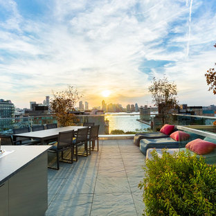 Mid-sized trendy rooftop outdoor kitchen deck photo in New York with no cover