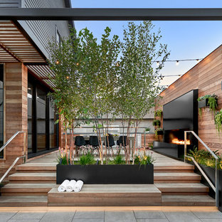 Design ideas for a contemporary back terrace and balcony in Chicago with an outdoor kitchen.