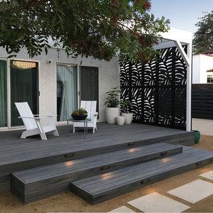 Ispirazione per una piccola terrazza design dietro casa