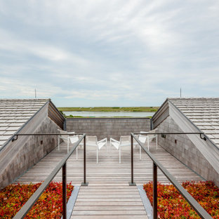 Example of a beach style rooftop rooftop deck design in Boston with no cover