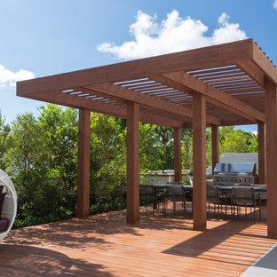 Deck - mid-sized contemporary backyard deck idea in Miami with a pergola