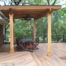Traditional Deck by Southwest Fence & Deck