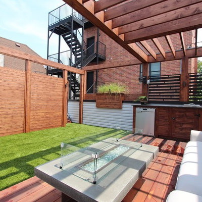 Mid-sized minimalist rooftop outdoor kitchen deck photo in Chicago with a pergola