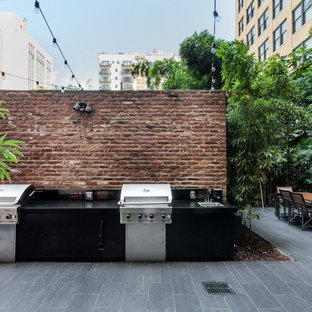 Outdoor kitchen deck - industrial outdoor kitchen deck idea in Los Angeles with no cover