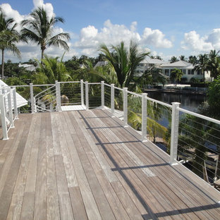 Large coastal roof terrace and balcony in Miami with no cover.