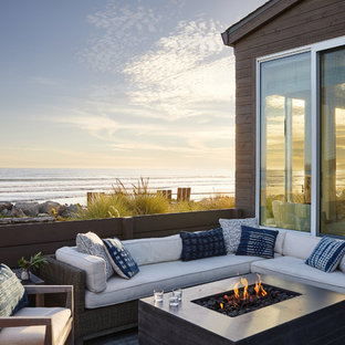 Deck - beach style side yard deck idea in San Francisco with a fire pit