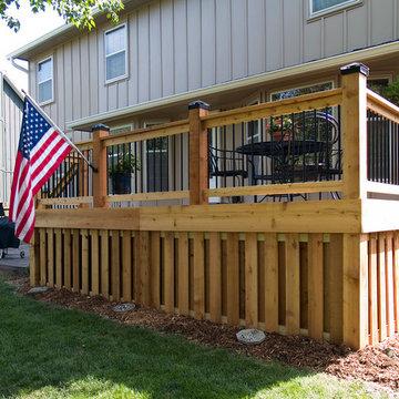 Stoerman - Cedar deck in Overland Park, Ks.  Stamped concrete patio & deck light