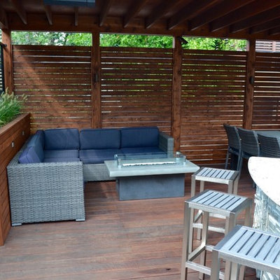 Example of a mid-sized minimalist rooftop outdoor kitchen deck design in Chicago with an awning