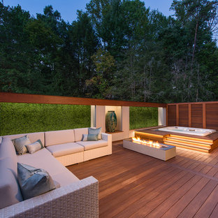 Mid-sized transitional deck photo in DC Metro with a fire pit and no cover
