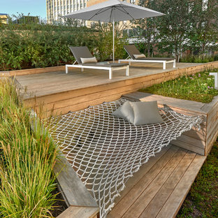 Example of a huge trendy rooftop outdoor kitchen deck design in Chicago with a pergola
