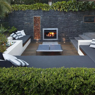 Design ideas for a contemporary backyard deck in Sydney with a fire feature and no cover.