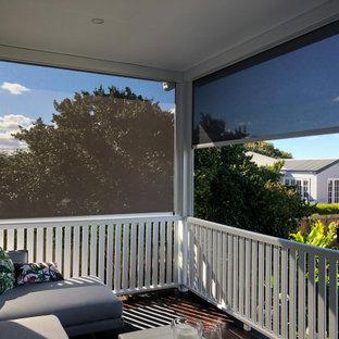 Deck - mid-sized transitional backyard privacy deck idea in Brisbane
