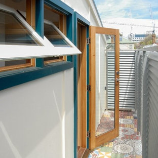 Design ideas for a small victorian roof terrace and balcony in Melbourne with a roof extension.