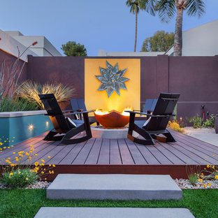Deck - large southwestern backyard deck idea in Phoenix with a fire pit and no cover