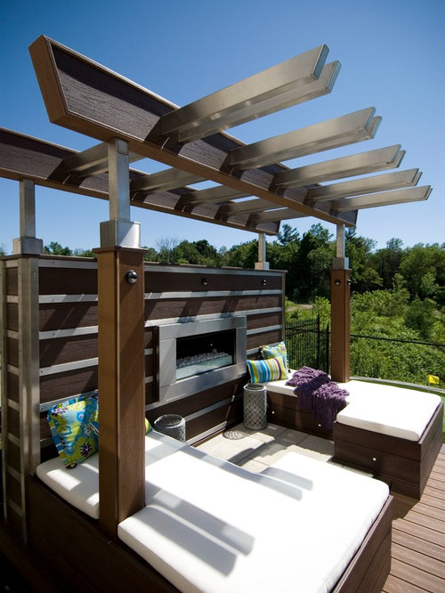 Example Of A Large Trendy Backyard Deck Design In Toronto With A Fire Pit  And A