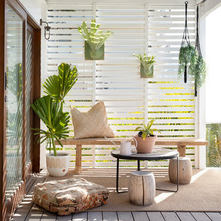 Beach style deck in Gold Coast - Tweed with a container garden and a pergola.