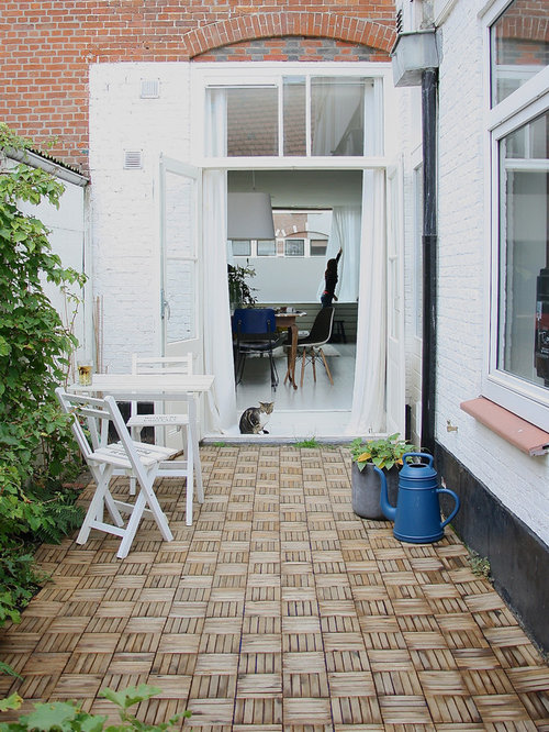 Example Of A Danish Patio Design In Amsterdam With Decking