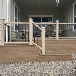 Example of a mid-sized classic backyard ground level mixed material railing deck skirting design in Denver with no cover
