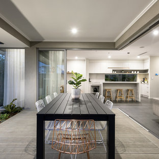 Photo of a contemporary backyard deck in Perth with a roof extension.