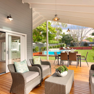 This is an example of a country side yard deck in Central Coast with a roof extension.