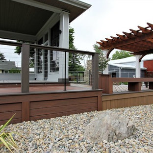 Inspiration for a mid-sized modern side yard deck skirting remodel in Other with a roof extension